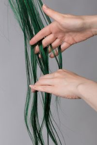 detangling a wig with fingers