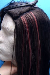 Weft sewn into wig to create highlights