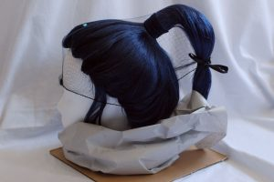 wig with protruding ponytail