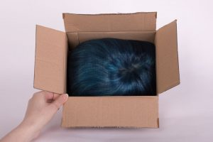 wig face down in box