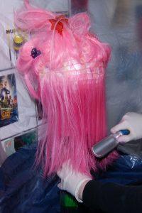 brushing in wig dye