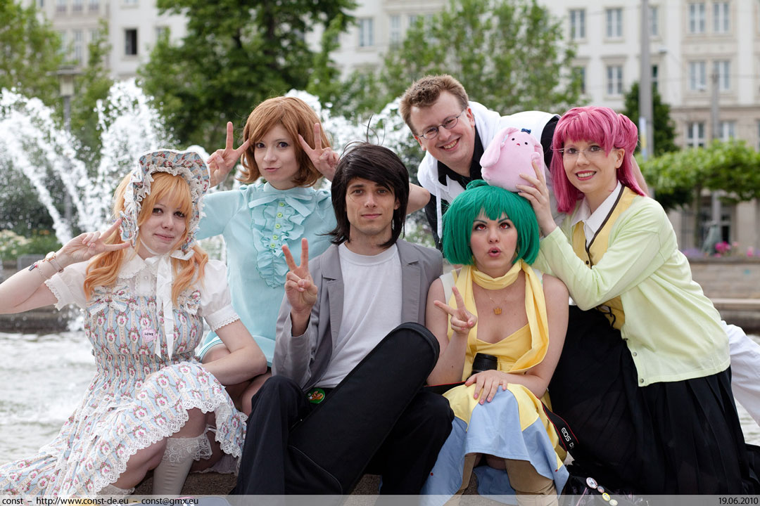 cosplayers holding up fingers for peace signs